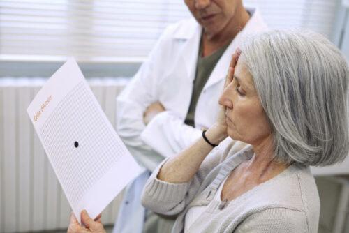 Woman looking at amsler grid