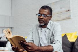 Elderly man reading about Diabetic Retinopathy